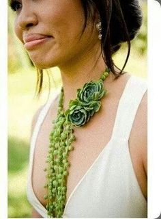 gorgeous neckline made with succulents and beads of pearl