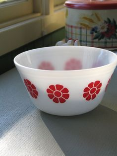 Federal Glass Red Daisy Mixing Bowl $25.00 A Federal Glass Red Daisy Mixing Bowl measuring 8″ in diameter and 4″ deep. This white glass mixing bowl is decorated with a Red Daisy design and shows virtually no wear. Overall, the bowl is in near mint condition with no visible scratches, chips or cracks. Marked on the bottom with an F inside a Shield along with Heat Proof U.S.A.  Out of stock  Category: Sold.