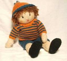 I thought Jesse might enjoy having a bright set of clothes so made this orange and teal stripy jumper with matching short trousers and  hat. Sadly I did not have enough of the orange to make a set for his best friend Josie. She will have to wait a while for a new bright jumper and hat!