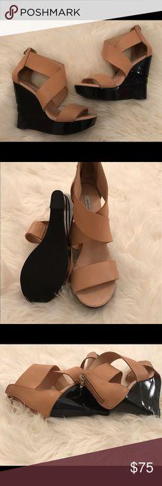 Diane Von Furstenberg Tan & Black Opal Wedge Crisscross sandals in tan. Black wedge heel. Zip closure at heel. 4.5 inch heel with 1 inch platform. Leather upper and rubber sole. Diane von Furstenberg Shoes Wedges