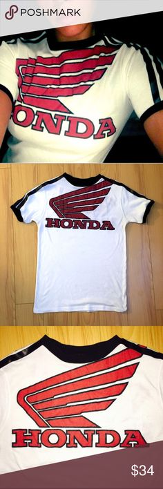 Bada$$ Vintage Honda Tee Super cool retro Honda T shirt. Vintage and soooo soft. Features an awesome old school Honda graphic on both the front and the back in the same place, and two leather racing stripes on each sleeve. This re is so unique and cool for that tomboy feel !! vintage Tops Tees - Short Sleeve