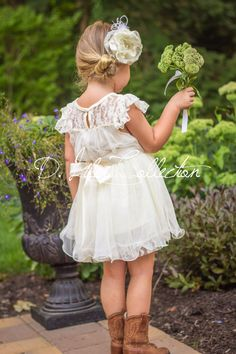 Stunning ivory, vintage-inspired, soft delicate lace dress with beautiful English tulle. The darling, detachable satin ribbon sash has a matching crystal and pearl embellished frayed chiffon flower.