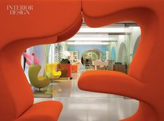 """From """"Ugly Betty"""" TV show set - Egg chairs in background are completely at home in set whose design concept was based on the futuristic look of an iPod."""