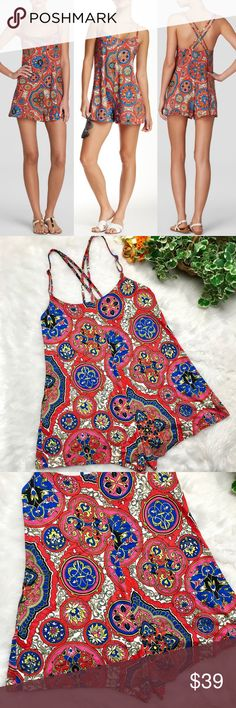 Lucky Brand Groove Romper One Piece XS/ S EUC Boho perfection with this colorful romper from Lucky Brand! This one piece is absolutely perfect for festival season just around the corner! Criss cross strap detail on back of romper for added flare. Made from a soft lightweight material making it easy to move and grove around. Hardly any wear, like new, great condition!  Women's size X-Small/ Small Bust: 16 inches across  Length: 22 inches long Lucky Brand Pants Jumpsuits & Rompers