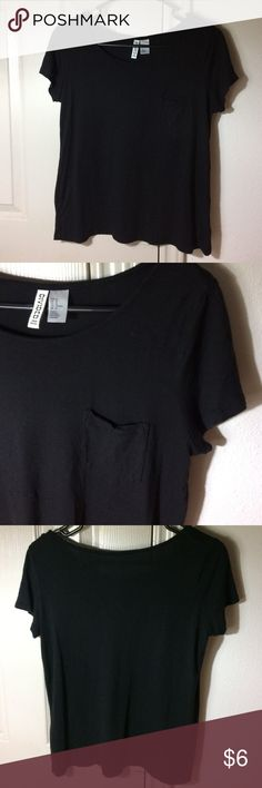 Basic black loose fitting tee shirt from H&M 100% rayon.. thin material, very comfortable loose fitting shirt. Can be worn with anything to be casual or a little dressed up. H&M Tops Tees - Short Sleeve