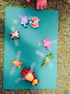 Taking off taped toys, 20 activities for 12-18 months old
