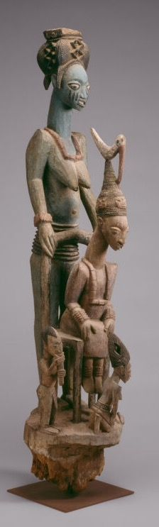 Veranda Post of Enthroned King and Senior Wife   Olowe of Ise (died 1938) Yoruba Ikere, Ekiti region, Nigeria From the palace of the ogoga (king) of Ikere  Veranda Post of Enthroned King and Senior Wife (Opo Ogoga), 1910/14  Wood and pigment 152.5 x 31.75 x 40.6 cm (60 x 12 1/2 x 16 in.)  Major Acquisitions Centennial Fund, 1984.550  African Art and Indian Art of the Americas Gallery 137  This veranda post is one of four sculpted for the palace at Ikere by the renowned Yoruba artist Olowe…
