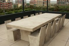 The design for this handcrafted dining table was conceived by working with the terrazzo-like technique of mixing stone aggregate with a malleable substrate. This aggregate and fiberglass table appears as if it was created from a solid slab of concrete res Concrete Outdoor Furniture, Concrete Dining Table, Slab Table, Patio Dining, Rustic Furniture, Outdoor Dining, Outdoor Furniture Sets, Antique Furniture, Dining Tables