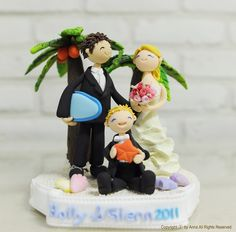 cake topper for wedding renewal in Hawaii!! How cute!