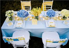 baby-blue-and-yellow-wedding-inspiration  Love the yellow sash on chairs - great way to accent yellow.  Centerpieces are fabulous as well!!