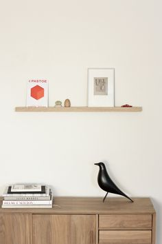 18 Decorative Animal Objects That Blur The Line Between Toys And Decor // This classic Eames House Bird became an iconic figure after it frequently appeared as an accessory in many photographs by Ray & Charles Eames. Charles Eames, Ray Charles, Wooden Animals, Wooden Toys, Scandinavian Style, Home Decor Accessories, Floating Shelves, Living Spaces, Furniture Design