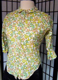 vintage 1960s Mad Men peach yellow aqua olive floral print blouse- medium. $45.00, via Etsy.