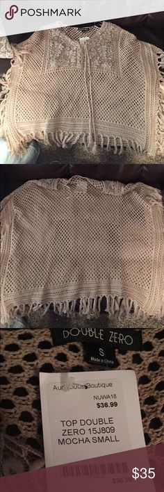 Boutique poncho Never worn! Beautiful poncho in a mocha color. Still has tags on it! Sweaters Shrugs & Ponchos
