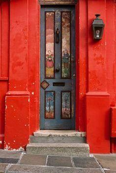 Door framed in red.