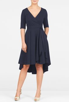 Our cotton jersey knit wrap dress is styled with a surplice V-neck and a cross-over skirt with a high-low hem for a modern update on a classic.