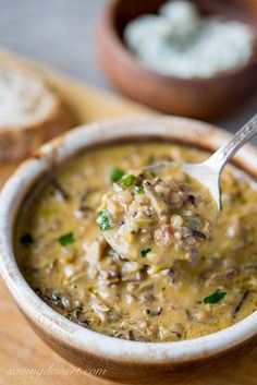 Wild Rice & Mushroom Soup Thick, rich, hearty, earthy and comforting - this soup is uniquely different and perfect for the mushroom lover in your house. - Hearty and filling ~ Wild Rice & Mushroom Soup Plat Vegan, Mushroom Soup Recipes, Wild Mushroom Soup, Mushroom Rice, Healthy Mushroom Soup, Hearty Soup Recipes, Best Soup Recipes, Mushroom Gravy, Mushroom Risotto