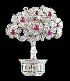 Platinum diamond and ruby Udall and Ballou brooch.