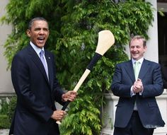 Hurling one of our national games: Obama takes to the field as a hurling full forward with Enda Kenny in supports as corner forward. Greatest Presidents, American Presidents, Michelle Obama, Hurley Stick, Mr Obama, Presidente Obama, Irish American, Facial Expressions