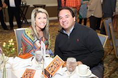 """Kristin Norman and Dr. Scott Wagner at the Nancy and Greg Ledford table. """"Jimmy Miller's Bracket Breakfast for Piedmont CASA"""" on March 14, 2016. Image by Jennifer Byrne Photography."""