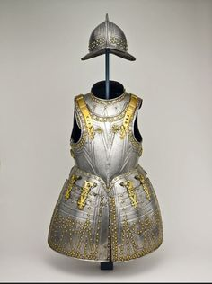 Studded with steel brass-capped rivets within embossed V-shaped motifs, a pikeman's armor included a helmet (pott), cuirass, gorget (collar), and tassets (riveted steel skirt plates attached to the breastplate). The patterned breastplate with bulbous tassets reflects the style of a doublet, with a wide full skirt over bulky trousers, which was fashionable at this time. The shoulder strap reinforcement and tasset hinges suggest that this harness belonged to an officer of the English Pikemen.
