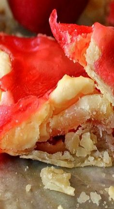 Candy Apple Slab Pie~ sweet, fresh, apple pie filling is layered between two buttery, flaky slabs of pie crust and then topped with crispy crackles of bright red, cinnamon candy goodness.  /  ohbiteit.com