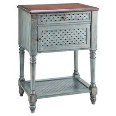 "1-drawer end table with turned legs and a hand-painted aged blue finish.  Product: End tableConstruction Material: WoodColor: Aged blueFeatures:  Country cottage styleTurned legsOne door Dimensions: 31.5"" H x 22"" W x 15.75"" D"