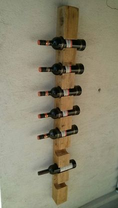 Wall wine rack for eight bottles. We can print any text you like. 149 cm x 9,7 cm x 10 cm  Bottle slots is 7,6 cm.  https://www.dropbox.com/sc/6wfh0xy33jg5kca/AAAhZKxUIoJtOEJLMBPrmxt6a