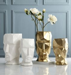 Stylish Geometric Human Face VaseAlmost a work of art in itself, this Stylish Geometric Human Face Vase will finish off your flower or plant arrangement with aplomb.    Its strong, chiselled features are showcased in porcelain white or ceramic gold. Paired together in the same colour or both colours but in differing sizes will make such a visual impact in your home.    These stunning pieces are substantial in size. The smallest size is 19cm wide x 27cm high and the largest standing proud at… Ceramic Plant Pots, Ceramic Vase, Small Succulents, White Vases, Metal Flowers, Nordic Style, Home Interior, Flower Pots, Colours