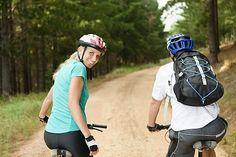 Man mountain biking on dirt path Stock Photography