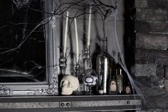 DIY gothic 'dungeon of horror' Halloween mantel: This creepy, white skull came from the bottom of a dollar store bin, and the chalky white paint from a craft store. We could have used silver or black, as well. Visit Rich's blog for DIY tips on how to create this look.