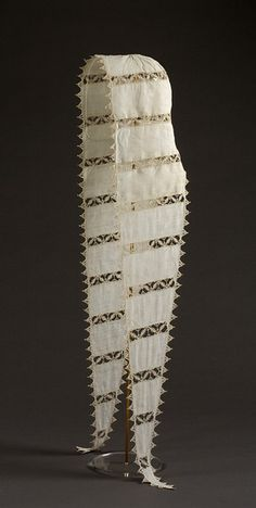 Coif with lappets.  From either Flanders or Italy.  ca. 1550-1600   Artist/Maker: Unknown.  Materials and Techniques:  Linen with cutwork and needle lace.