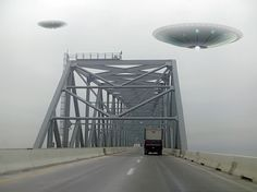 A sci-fi, fantasy image of a pair of UFOs above the Chesapeake Bay Bridge during thick fog weather conditions. POV is east-bound on the bridge.