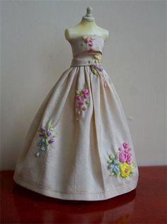 silk hand embroidered gown. I have hand embroidered this gown with roses and pretty flowers giving it a Victorian look. A simple but exquisite gown created on a 5 inch top quality mannequin.