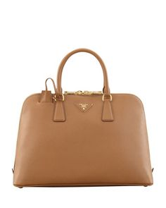 Actually purchased this last year (or the year before) and I just noticed that the corners are scuffed ... so much for my belief that this leather is super tough! | Saffiano Medium Promenade Bag, Brown (Caramel) by Prada at Neiman Marcus.