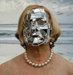 Broken Mirror Mask. Maybe I'll do this for Halloween and make some matching mirror heels.....