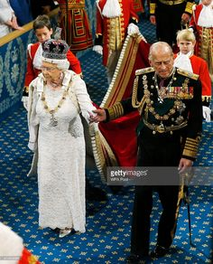 Queen Elizabeth II  is accompanied by Prince Philip, Duke of Edinburgh as they proceed through the Royal Gallery before the State Opening of Parliament in the House of Lords, at the Palace of Westminster on May 27, 2015 in London, England. (Photo by Suzanne Plunkett /WPA Pool/Getty Images)