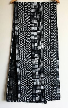 This table runner features my hand-carved, block printed African Mudcloth inspired pattern in white ink on a beautiful lightweight pure black linen. Every piece has been hand-printed in non-toxic fabric inks with my original illustrations. Linen is a great, ecofriendly material that