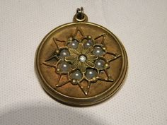 A Round Victorian  Gold Filled Locket With Seed Pearls