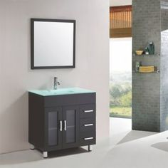 This all black luxury vanity for one comes complete with style and plenty of room for storage. The all glass basin and counter top sit beautifully against the black lacquer finish. With sleek silver handles on the drawers and a matching mirror, this vanity will enhance any bathrooms style with elegance.