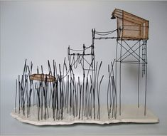 Isabelle Bonte uses wire to form the framework for houses, boats and clouds.
