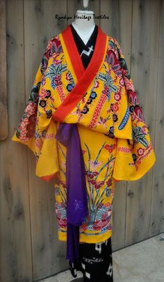 Traditional Ryukyu kimonos are constructed of handwoven fabric with bingata natural dye designs.  The underlying fabric is also handwoven, however the weave structure differs and consists of the Kasuri Ikat style.