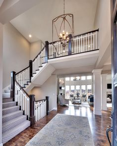 Entry: curved staircase, open floor plan, overlook from the upper level