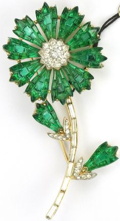 Trifari 'Alfred Philippe' Gold and Invisibly Set Emerald Flower Pin
