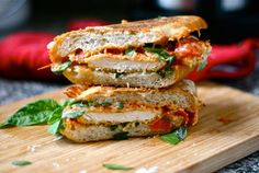 Chicken Parmesan Grilled Cheese - Tomato sauce,  1 boneless, skinless chicken breast,  salt & pepper,  1/2 c flour,  2 tsp Italian seasoning,  1 egg,  1 tablespoon olive oil,  2/3 c bread crumbs,  1/4 c Parmesan cheese,  Deli Rolls,  Butter,  Fresh Basil