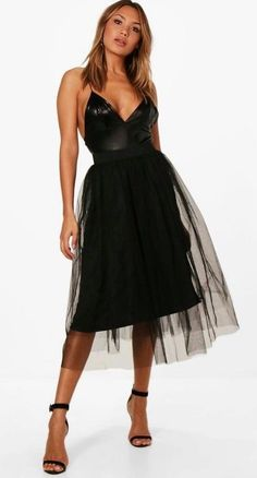 Every wardrobe requires a tulle skirt, always chic and in style. This black version features an elasticated waistband and is midi length. Style it with a crop top and heels for the perfect party outfit! | eBay!