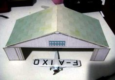 Hangar Paper Model In 1/100 Scale - by Monsieur E - Via Le Forum En Papier - == - A very well done paper model of a Hangar in 1/100 scale, created by French designer Monsieur E and originally posted at Le Forum En Papier website.