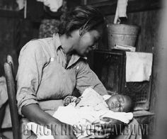 African American migrant cotton picker and her baby. Near Buckeye, Maricopa County, Arizona, 1937