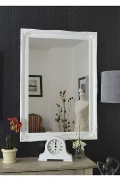 Here we have a classic white, hand finished, French style mirror. The design boasts ornate detailing in all four corners and sides.