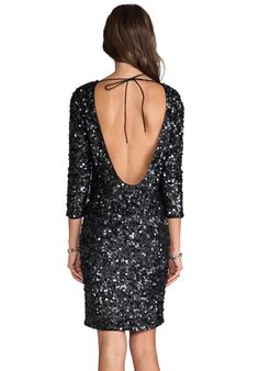 A backless dress with long sleeves is a wonderful way to show skin while remaining somewhat discreet. ANTIK BATIK Lulu Dress
