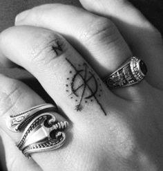 Finger tattoo compass
